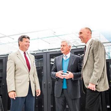 business men talking in a datacentre
